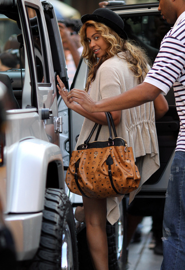 Beyonce Knowles follows husband Jay-Z into their waiting SUV in the SoHo neighborhood of New York City